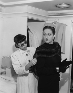 """Dorothy Lamour with designer Edith Head adjusting a costume for """"My Favorite Brunette."""""""